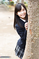 Kasugano Yui standing behind tree wearing uniform