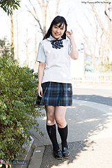 Student Outdoors Wearing Uniform In Plaid Skirt Wearing Socks