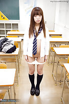 Standing in classroom shirt unbuttoned lowering panties showing her shaved pussy