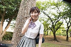 Student Standing Under Tree