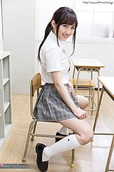 Sitting On Chair In Classroom Pulling Skirt Hem Down