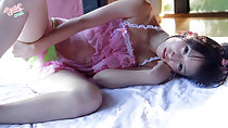 Lying on her side legs parted frilly lingerie