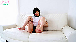Sitting Back On Couch Wearing Her Gym Class Outfit Legs Raised Bare Feet