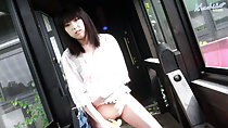 Machiko in corridor bottomless lifting top up over her shaved pussy masturbating with banana