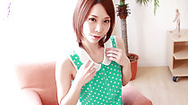 Ryouko seated on chair wearing green polka dot top auburn short hair
