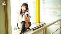Minami H seated beside window in classrroom wearing kogal uniform long hair legs raised