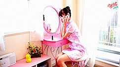 Minami H Seated At Dressing Table Wearing Pink Cheongsam Talking On Telephone Yellow Rubber Duck On Shelf