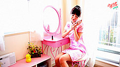 Turning Phone Off In Pink Cheongsam At Dressing Table