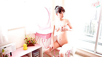 Minami H sitting naked at dressing table clutching her small breasts hand resting on thigh shaved pussy