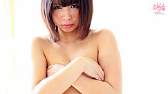 Short Haired Minami S With Her Arms Folded Across Her Breasts