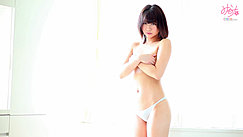 Standing Topless In Front Of Window Arms Folded Across Her Breasts Wearing Blue Panties