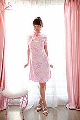 Standing In Front Of Window Wearing Pink Cheongsam High Heels