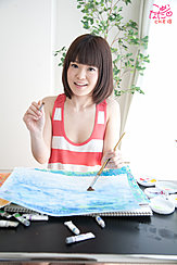 Seated Holding Paintbrush