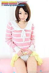 Raising Hem Of Her Skirt Exposing Her White Panties Short Hair Curls Around Her Face In Pink Top
