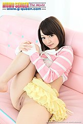 Seated On Couch Leg Raised Hands Clasped Together On Her Knee Short Hair Yellow Skirt Raised Above Her Shaved Pussy