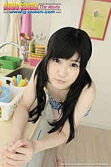 Leaning Against Kitchen Worktop Pigtails Down To Her Forearms