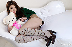 Lying On Couch Holding Teddy Bear Wearing Short Skirt Knee High Socks And Shoes