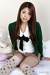 Ayaka Minamino Sitting On Couch Hands By Her Sides Long Hair Down Over Her Shoulders Knees Pressed Together In Knee High Socks