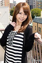 Standing On Balcont Wearing Striped Top Auburn Long Hair