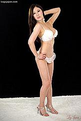 Kazuki Yuu Wearing White Frilly Underwear In High Heels Long Hair In Pearl Necklace Hand On Hip