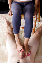 Rubbing hard cock with her bare feet painted toenails