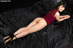 Lying On Her Front Dress Raised Exposing Her Nice Ass Wearing Black High Heels