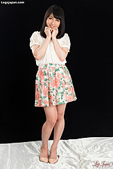 Wearing White Top In Floral Skirt
