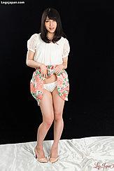 Saionji Reo Raising Hem Of Dress Exposing Her Panties In High Heels