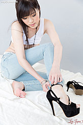 Removing Her High Heels In Jeans