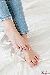 Bare Feet Wearing Jeans