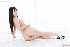 Seated On Her Side Looking Over Her Shoulder Long Hair Bare Ass White High Heels