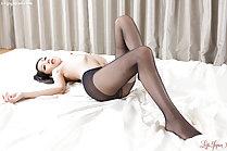 Long haired beauty Rio Kamimoto masturbating in pantyhose