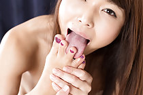 Seated naked and with painted toenails Shino Aoi sucks her toes
