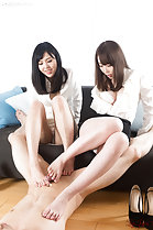 Girls giving footjob with bare feet on sofa