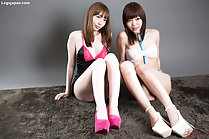 Girls seated together wearing lingerie in high heels