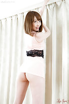 Aya Kisaki looking over her shoulder dress riding up over her ass