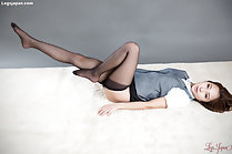 Stretching out her legs in black pantyhose