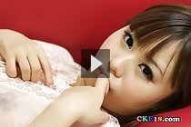 Mikuru fondling small breasts and masturbating on red couch